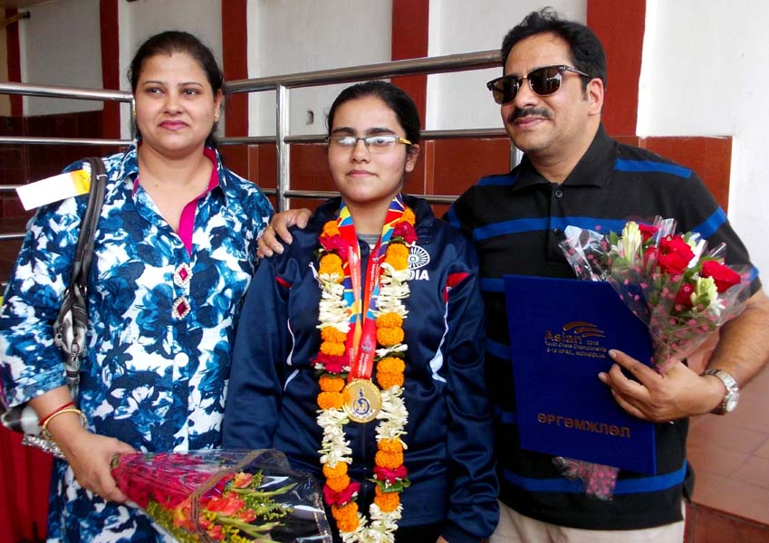 Odisha chess player Anwesh Mishra with her parents in Bhubaneswar on April 16, 2016.
