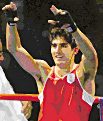 Indian boxer celebrates his victory in Beijing Olympics in August, 2008.