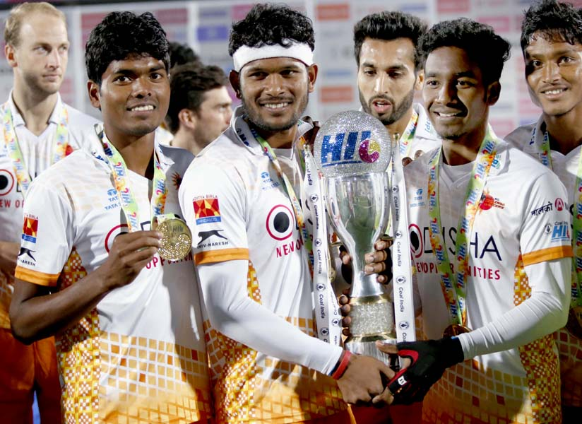 Kalinga Lancers' Odisha players (L to R) Nilam Sanjeep Xess, Amit Rohidas, Dipsan Tirkey and Anand Lakra with the Hockey India League trophy in Chandigarh on Feb 26, 2017.