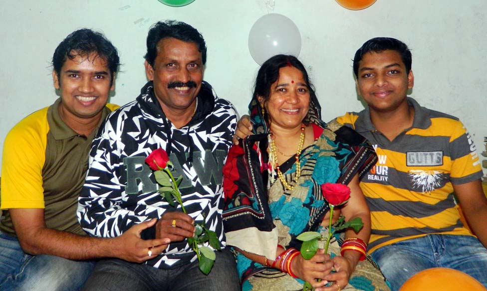 File photo of Odisha sports educationist Dr Manamohan Rout with his wife and two sons.