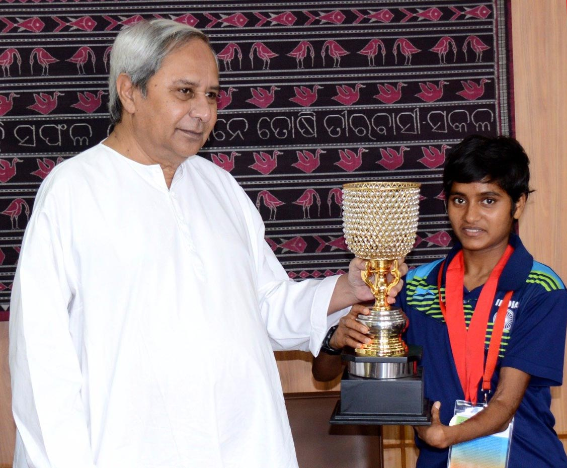 Chief Minister Naveen Patnaik felicitates para athlete Jayanti Behera at the State Secretariat in Bhubaneswar on August 10, 2017.