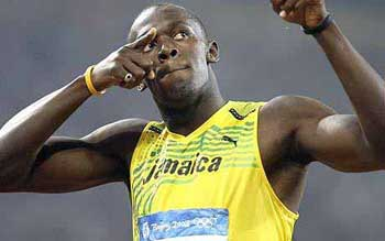 Jamaica``s Usain Bolt celebrates his victory in Beijing Olympics.