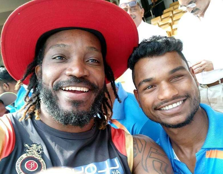 Undated photo of Odisha blind cricketer Sukhram Majhi with West Indies superstar Chris Gayle.