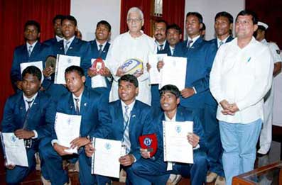 Governor M C Bhandare felicitates the KISS rugby team in Bhubaneswar on 26th August 2008