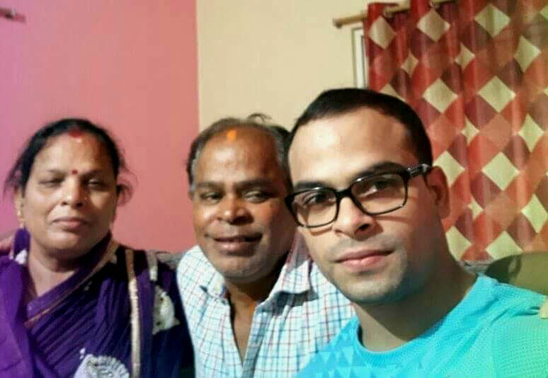 Odisha international gymnast Rakesh Kumar Patra with his parents at their Puri home on May 4, 2018.