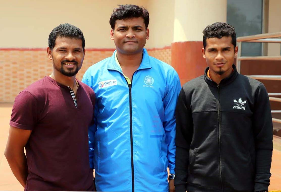 Odisha hockey stars Birendra Lakra (L) and Shilanand Lakra (R) with technical official Nisan Jyoti Mohanty at BP Airport in Bhubaneswar on 1st April 2019 on their return home from Ipoh, where India won the silver medal in the 28th Sultan Azlan Shah Cup Tournament.