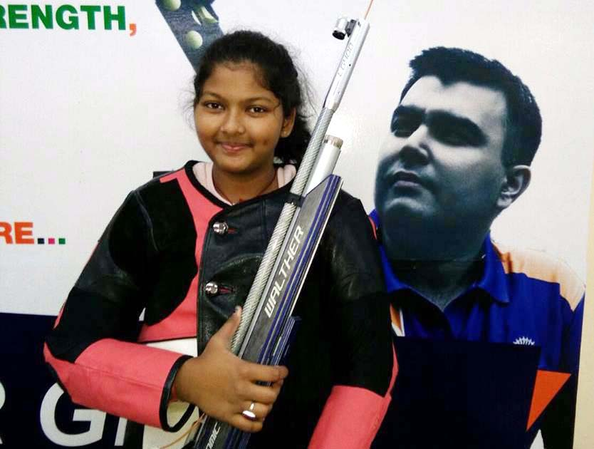 File photo of Bhubaneswar shooter Kashika Pradhan with the pic of Olympian Gagan Narang