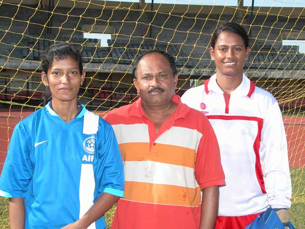 Woman football international Sradhanjali Samantaray with her coach Nanda Kishore Patnaik and India teammate Ranjita Mohanty at Kalinga Stadium in Bhubaneswar.