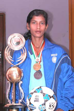 Star woman footballer Sradhanjali Samantaray with a trophy at her residence in Bhubaneswar.