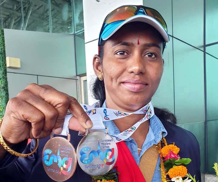 Odisha woman athlete Parbati Sethi poses with her silver and bronze medal, bagged at the European Masters Games in Torino, Italy in July-August, 2019.