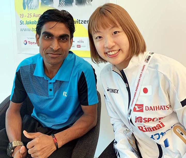Odisha para-badminton star Pramod Bhagat with Japanese woman star shuttler Nozomi Okuhara at the 2019 BWF World Championship in Basel, Switzerland.