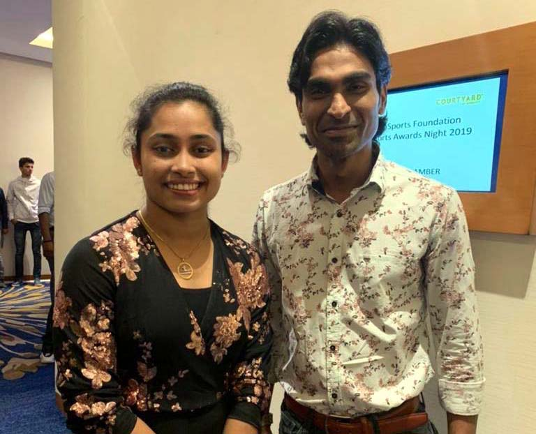 Undated photo of Odisha para-badminton star Pramod Bhagat with gymnastics Olympian Dipa Karmakar.