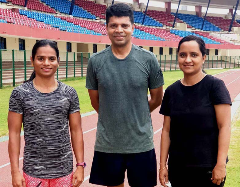 Odisha athletics star Dutee Chand with IAS Officer couple V Karthikeyan Pandian and Sujata Karthikeyan at Kalinga Stadium, Bhubaneswar on 25 June, 2020.