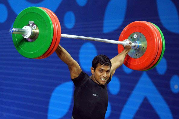Odisha weightlifter K Ravi Kumar lifts for gold medal at the 19th Commonwealth Games in New Delhi on 6 October, 2010.