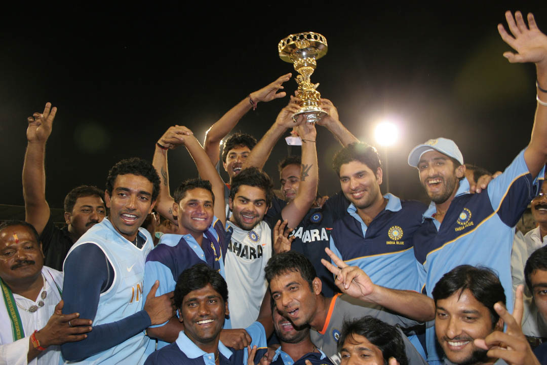 India Blue team lifts the NKP Salve Trophy after winning the Challenger Series in Cuttack on Sunday.