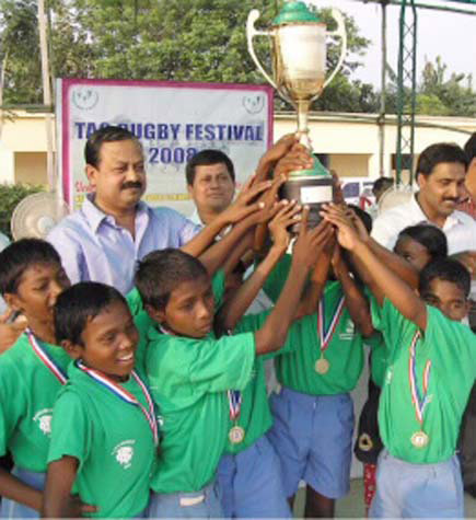 Kiss Lions celebrate with inter-school trophy in Bhubaneswar on Oct 31, 2008.