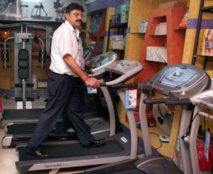 Grand Slam Fitness Managing Director Raman Sood demonstrates the functioning of a treadmill at the new exclusive showroom of the company in Bhubaneswar on May 14, 2008.