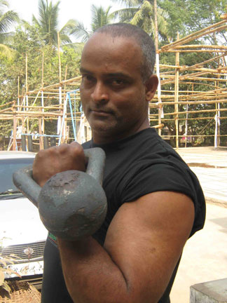 Eminent karate and powersports coach Hari Prasad Pattanayak demonstrates the use of kettlbell in Bhubaneswar on Jan 15, 2009.
