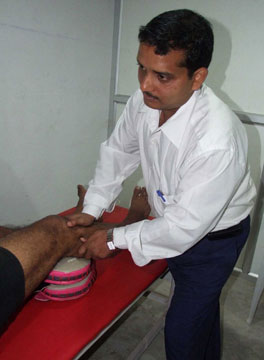 Professor Umasankar Mohanty treats an injured sportsperson in Bhubaneswar on 25th Dec. 2008