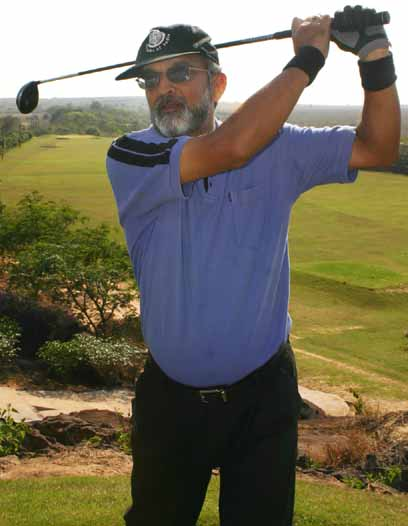 BGC golf captain P K (Bhumi) Mohanty demonstrates a stroke at the club course in Bhubaneswar on Feb 23, 2007.