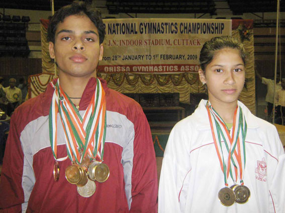 All-around champions Rakesh Kumar Patra (Left) and Rucha Divekar at the 49th Junior National Gymnastics Championship in Cuttack on Feb 1, 2009.