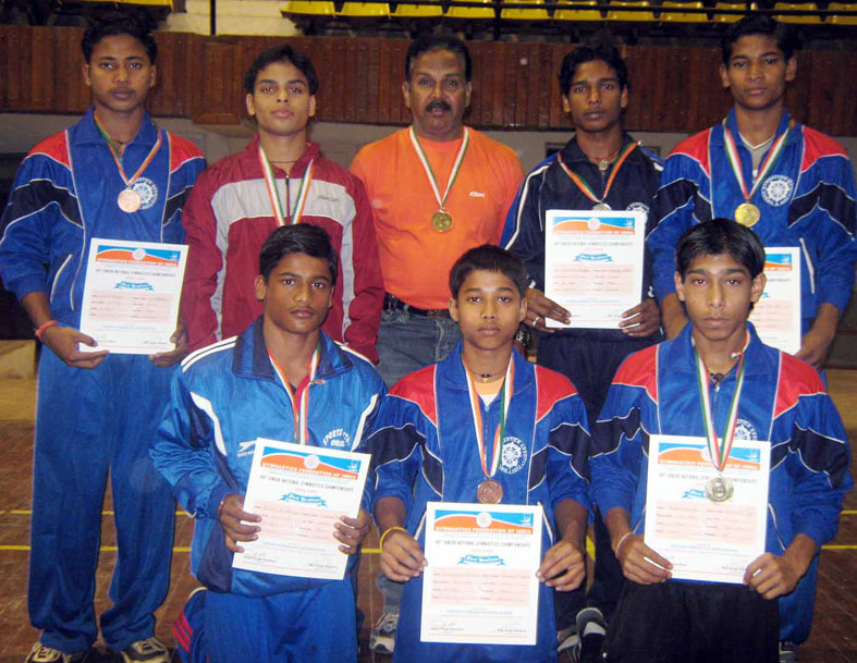 Orissa team pose after winning silver medal in boys` team event of the 49th Junior National Gymnastics Championship in Cuttack on Feb 1, 2009.