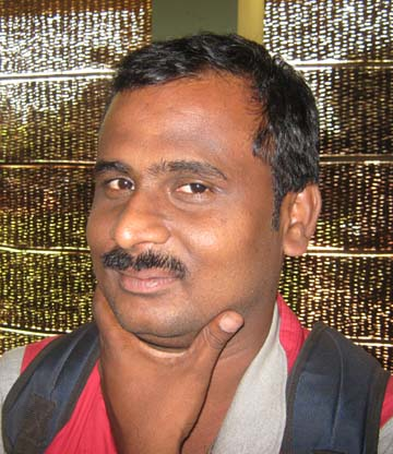 Orissa`s part-time sports photographer <b>Bhabani Prasad Das </b>in Bhubaneswar on March 27, 2009.
