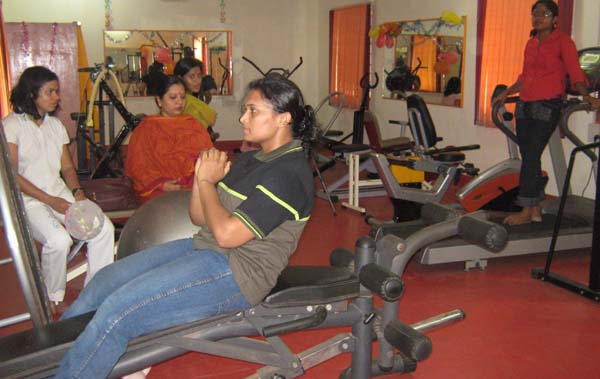Powerlifting ace Ranu Mohanty tests a machine at the newly launched women's gymnasium in Bhubaneswar on April 5, 2009.