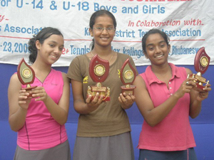 Ritika Nath (C), Nikkie Gargi (R) and Deveshi Debi with their trophies at the AITA Talent Series Tennis Tournament in Bhubaneswar on 22/05/2008.