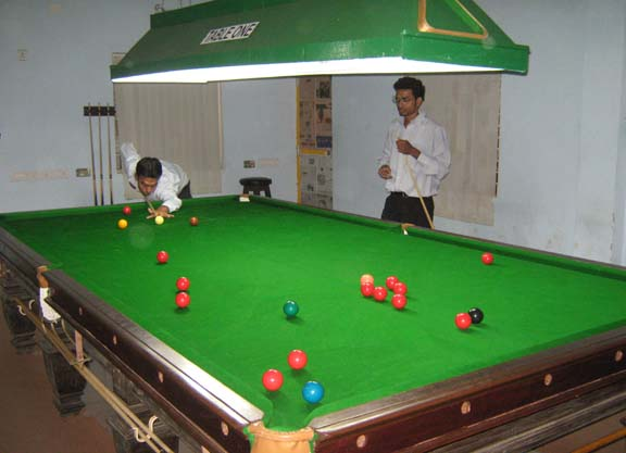 Cueists practise on the english table of the newly launched Cue Sport Academy in Bhubaneswar on April 16, 2009.