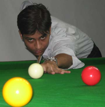 Mohammad Reza in action during the 1st CSA All-Orissa Open Snooker Tournament in Bhubaneswar on April 17, 2009.