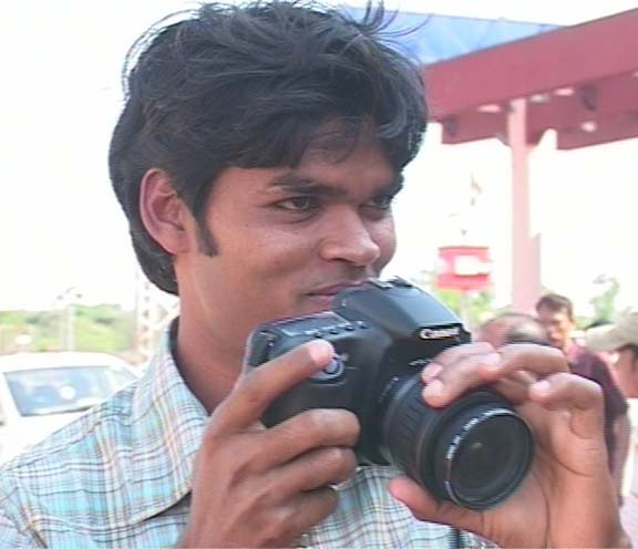 Hockey star <b>Prabodh Tirkey</b> taking a picture at the airport in Bhubaneswar on April 14, 2009.