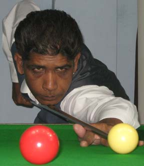 <b>Ahsan-ul Haque </b>aims for a putt at the CSA All-Orissa Open Snooker Tournament in Bhubaneswar on April 25, 2009.