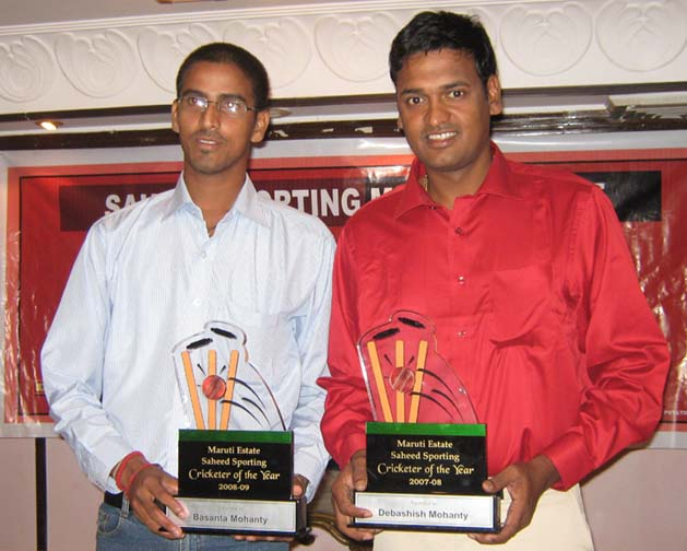 <b>Debasis Mohanty </b>(Right) and <b>Basant Mohanty </b>with the Maruti Estate Cricketer of the Year Award in Bhubaneswar on April 26, 2009.