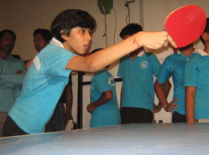 Leading girl paddler <b>Samartha Prusty </b>practices with robo-pong machine at the BTTA summer coaching camp in Bhubaneswar on <b>May 15, 2009.