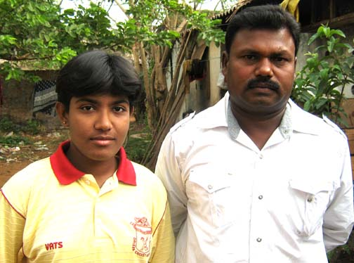 Orissa woman cricketer <b>Priyanka Priyadarshini Sahoo </b> with coach Khirod Behera (R) in Bhubaneswar on <b>May 16, 2009.