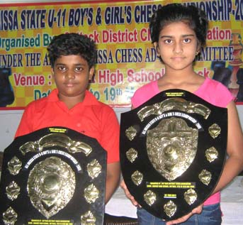 State under-11 chess champions <b>Sidhant Mohapatra </b>(Left) and <b>Pooja Senapati </b>with their trophies in Cuttack on <b>May 19, 2009.