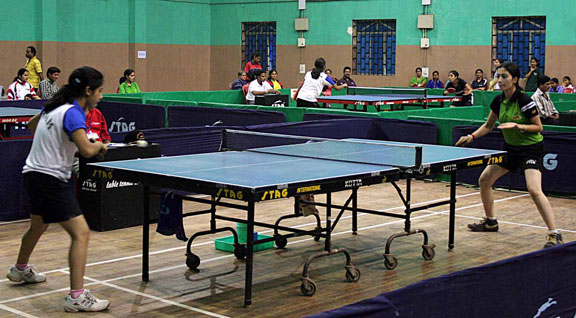 Table Tennis players compete for team title at the National Sports Festival for Women in Bhubaneswar on Jan 19, 2009.