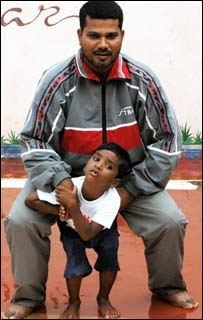 Eminent coach <b>Biranchi Das </b>with his adopted son and child marathon runner <b>Budhia Singh </b>in Bhubaneswar.
