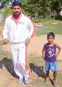 File photo of eminent judo coach <b>Biranchi Das </b>with his desciple <b>Bhudhia Singh </b>in Bhubaneswar.