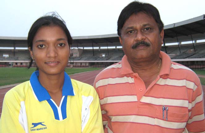 Woman football international <b>Sarita Jayanti Behera</b> with her coach Nanda Kishore Pattnaik in Bhubaneswar on <b>June 4, 2009.