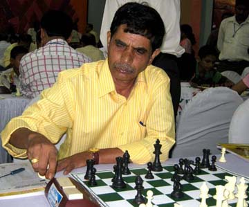 Former Orissa National `B` champion <b>Pabitra Mohan Mohanty</b> plays at the Open GM Chess Tournament in Bhubaneswar on <b>June 10, 2009.