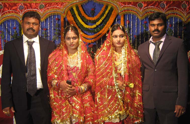 Orissa cricketer <b>Khirod Behera </b>(Left), his wife <b>Sudhansubala</b> (2nd from left), younger brother <b>Gouri Shankar </b>(Extreme right) and his wife <b>Laxmipriya </b> at their marriage reception party in Bhubaneswar on <b>July 3, 2009.