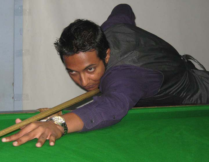 Orissa cueist <b>Jenson George </b> at the 15th State Junior Snooker Championship in Bhubaneswar on <b>July 30, 2009.
