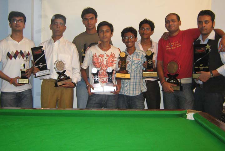 Champions and runners-up pose with trophies at the 15th State Billiards and Snooker Championship in Bhubaneswar on <b>August 9, 2009.