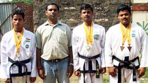 Taekwon-do medal winners with their coach (2nd from left) Manoranjan Patra in Bhubaneswar on May 25, 2008.