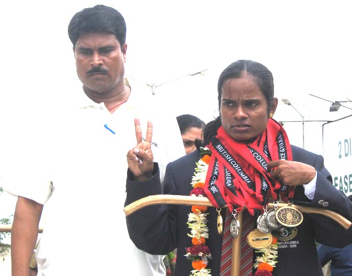 Police athlete <b>Saraswati Chand </b> with coach S P Burma in Bhubaneswar on <b>August 11, 2009.