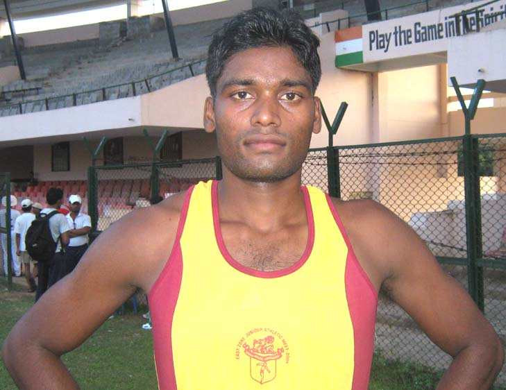 Orissa`s <b>Dharmedhar Mahanta </b>poses after equaling the 110m hurdles National record at the East Zone Junior Athletics Championship in Bhubaneswar on <b>August 17, 2009.