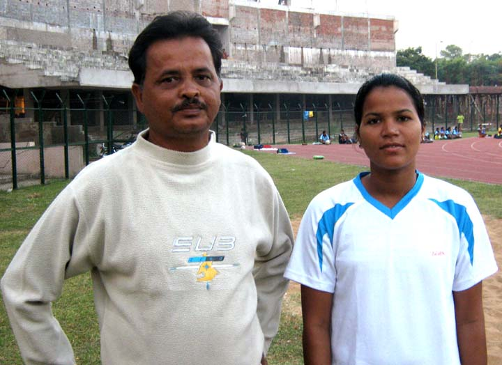 Orissa`s international woman footballer <b>Sasmita Mallick </b>with her coach <b>Bijay Kumar Kanugo</b> in Bhubaneswar on <b>Oct 24, 2009.