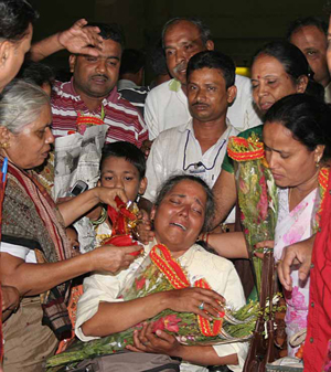 An ailing Kalpana Das is being greeted and consoled by her mother and family members on her returen home after a successful conquest of the Mount Everest, in Bhubaneswar on June 7, 2008.